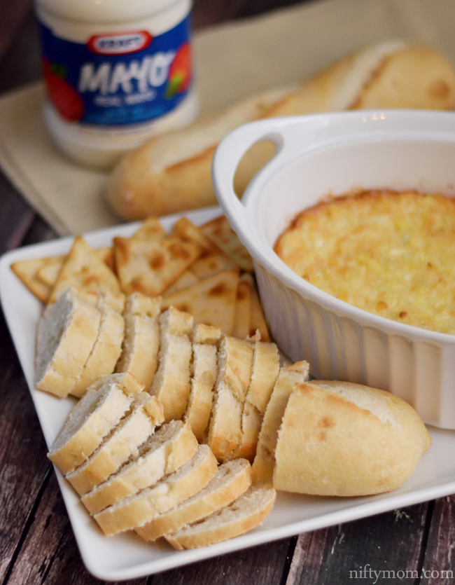 Hot Artichoke Dip served with sliced baguettes and Pita crackers