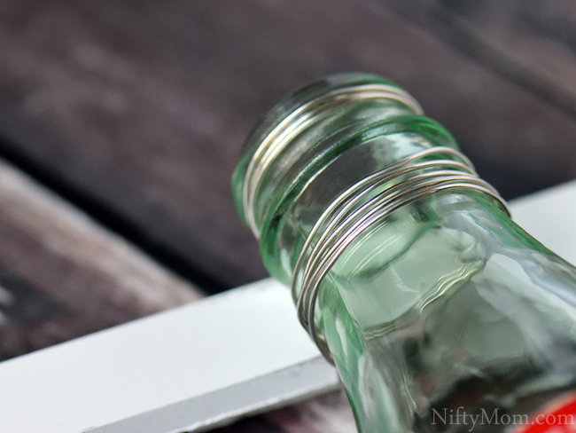 How to Hang a Coke Bottle on a Picture Frame with Wire