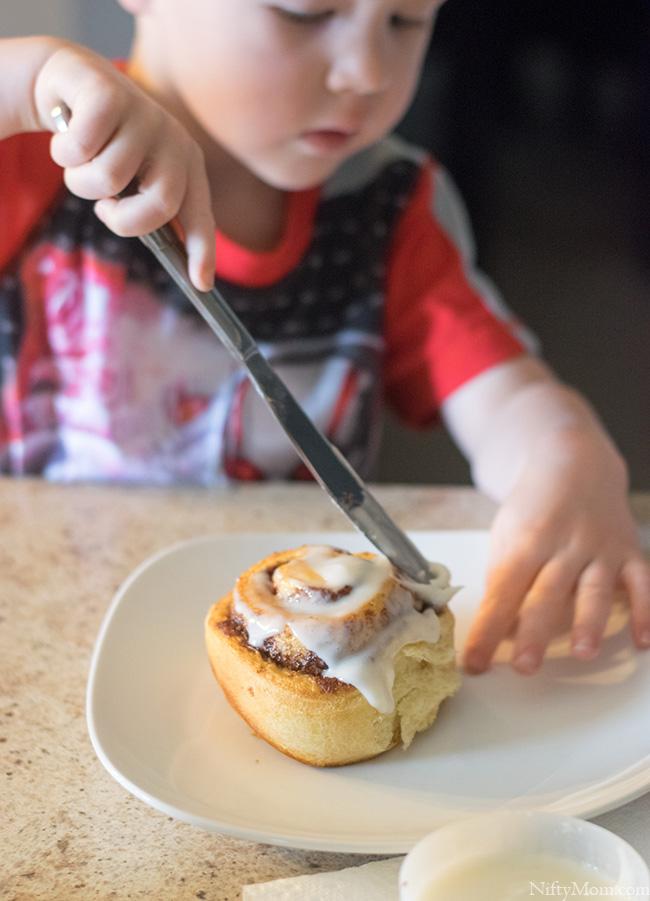 Weekend breakfast means the kids ice their own cinnamon rolls