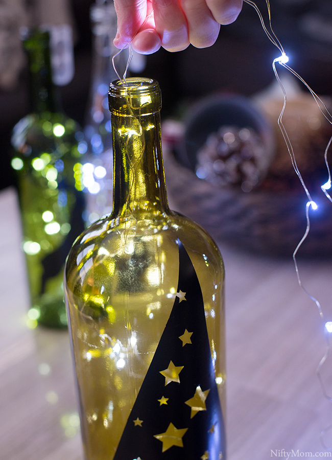 DIY Lighted Wine Bottle Holiday Decor & Centerpiece