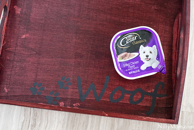Turn a basic wooden tray into a custom dog food tray! Plus download the free file for the vinyl cutouts